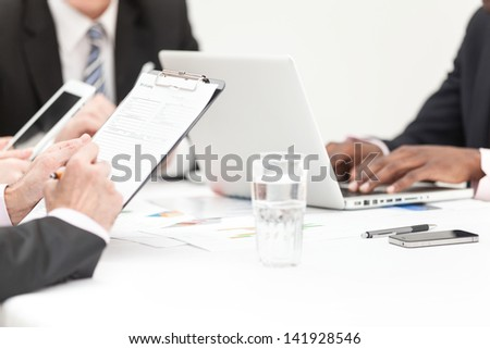 Close-up Of A Business People Hands Writing Note During Meeting - stock photo