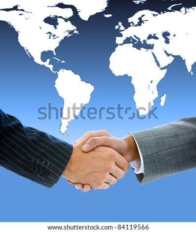 Close-up of a business people shaking hands against a white world map - stock photo