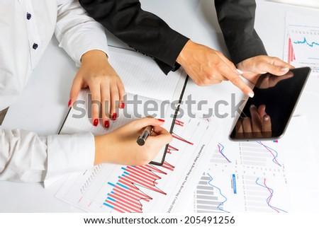Close up of a business woman hands during business presentation. - stock photo