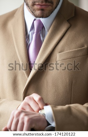 close-up of a businessman checking his watch - stock photo
