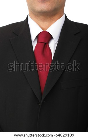 Close up of a businessman wearing a black suit, white shirt and red star tie.