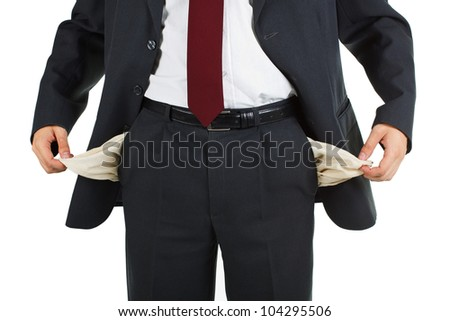 Close-up of a businessman wearing suit, tie and white shirt, pulling out both of his empty pockets - isolated on white