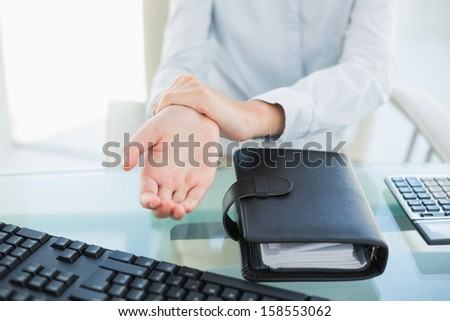 Close up of a businesswoman showing her hand in bright office