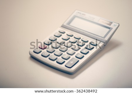 Close up of a calculator on desk - stock photo