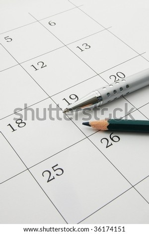 close up of a calendar page, with pen - stock photo