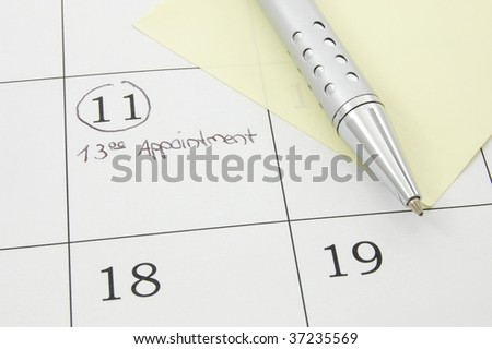 close up of a calendar page, with pen and notice