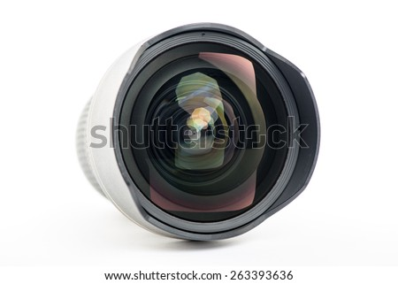 Close-up of a camera lens on white background