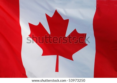 Close-up of a Canadian Flag Fluttering in the Wind - stock photo