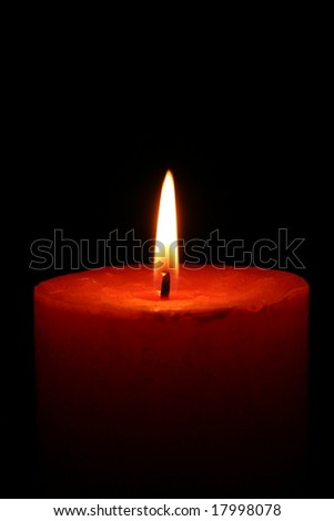 Close up of a candle with black background - stock photo