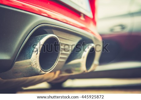 Close up of a car dual exhaust pipe - stock photo