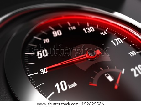 Close up of a car speedometer with the needle pointing 30 Km h, blur effect, conceptual image for safe driving concept - stock photo