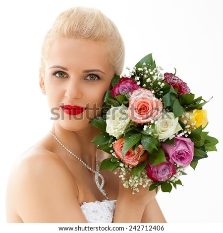 Close up of a caucasian bride holding flowers. Focus on her hair. - stock photo