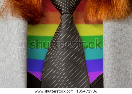 Close-up of a caucasian business woman with a tie,rainbow flag pattern - stock photo