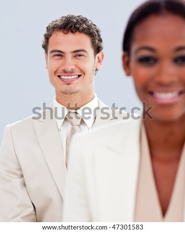 Close-up of a charismatic businessman and his colleague standing - stock photo