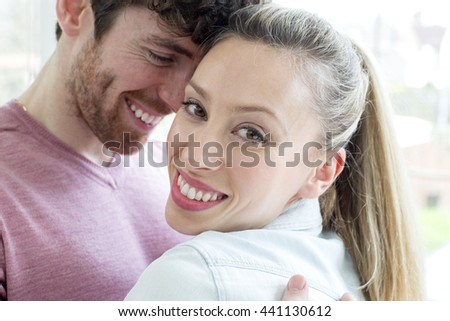 Close-up of a cheerful romantic couple embracing, having fun together.  - stock photo