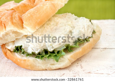 Close up of a chicken salad sandwich on a delicious croissant.