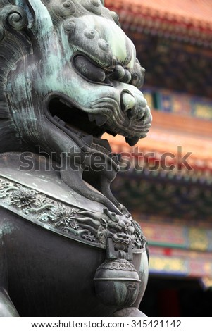 Close up of a Chinese Lion statue - stock photo