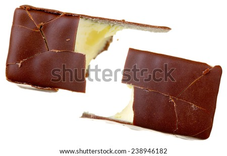 Close up of a chocolate cream-filled, isolated on white background - stock photo