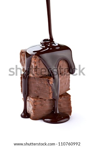 close up of a chocolate syrup on a cake on white background - stock photo