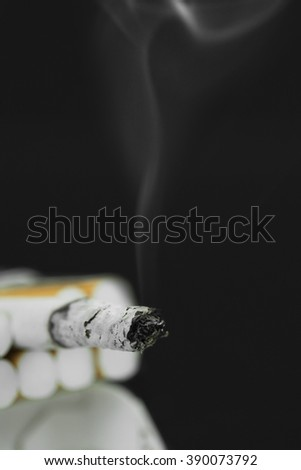 close up of a cigarette smouldering - stock photo