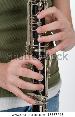 Close-up of a clarinetist's hands playing a clarinet. - stock photo