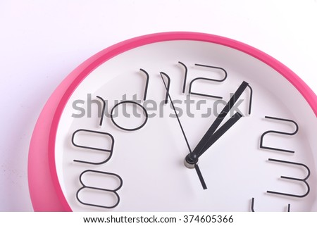 Close up of a clock isolated on white background