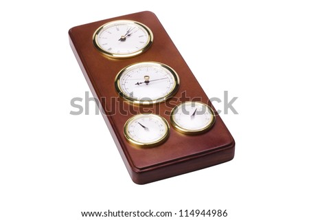 Close-up of a clock with thermometer hygrometer and barometer - stock photo
