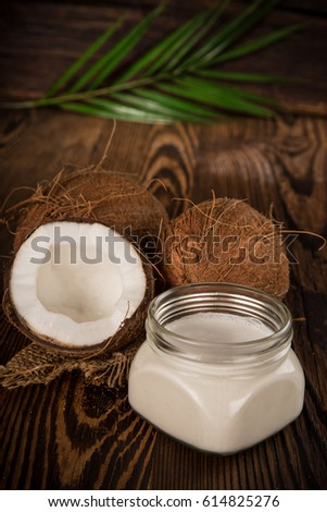 close up of a coconut milk on old wooden background