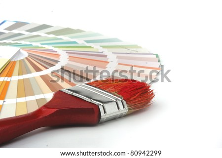 Close-up of a color palette and a brush on white background - stock photo