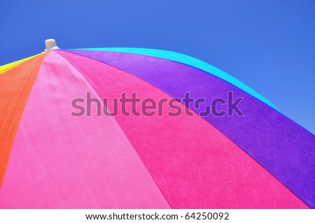 Close up of a colorful beach umbrella - stock photo
