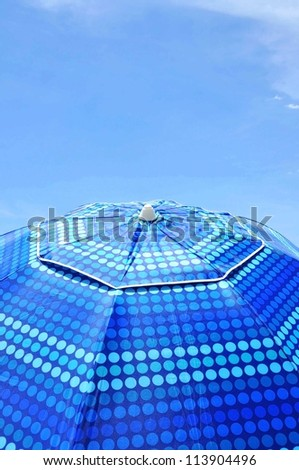 Close up of a colorful beach umbrella. Useful as cover art or background - stock photo
