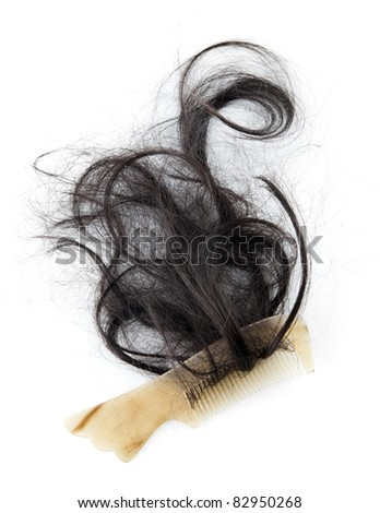 Close-up of a comb with lost hair on it, on white background - stock photo