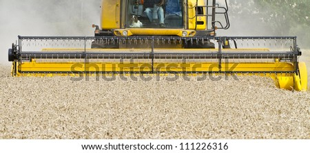 Close up of a combine harvester at work from the front - stock photo
