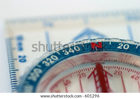Close-up of a compass, shallow depth of field. - stock photo