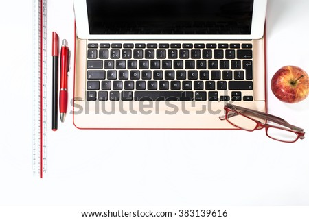 Close up of a computer keyboard with office items - stock photo