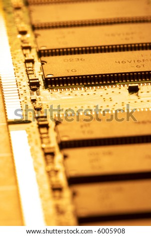 close up of a computer RAM memory in brown color. - stock photo