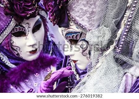 Close-up of a costume reveller poses during the Carnival in Venice, Italy. - stock photo