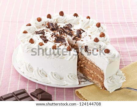 close up of a cream cake on white plate