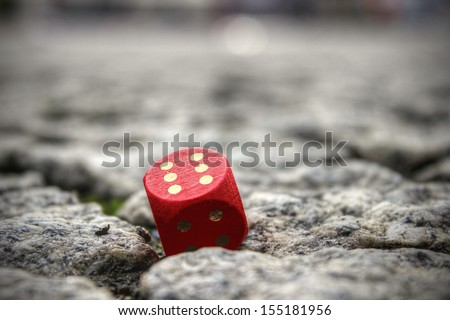 Close-up of a cube on the street * metaphor for prostitution - stock photo