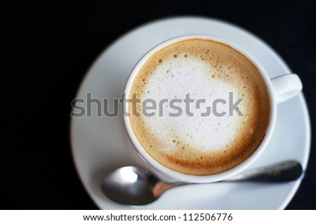 Close up of a cup of cappuccino - stock photo