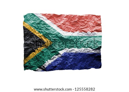 Close up of a curled paper on white background, print of the flag of South Africa - stock photo