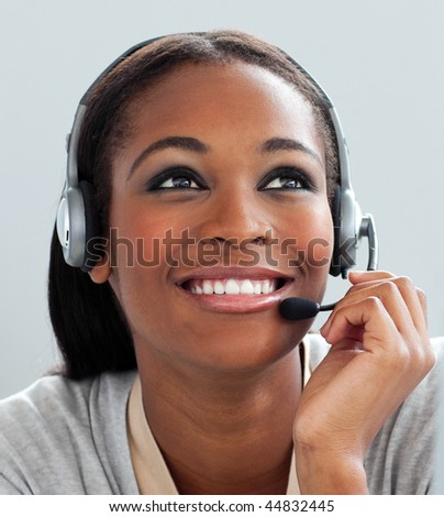 Close-up of a customer service representative with headset on at her desk