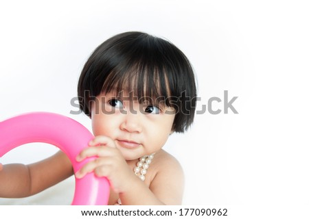 Close up of a cute baby girl - stock photo