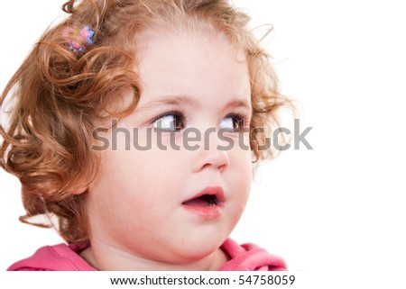 close-up of a cute  little girl looking to the side
