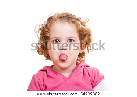 close-up of a cute  little girl sticking out tongue - stock photo