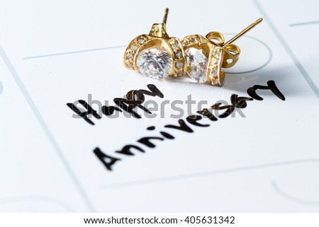 close up of a daily planner or calendar with a hand written to remember a special date like an anniversary - stock photo