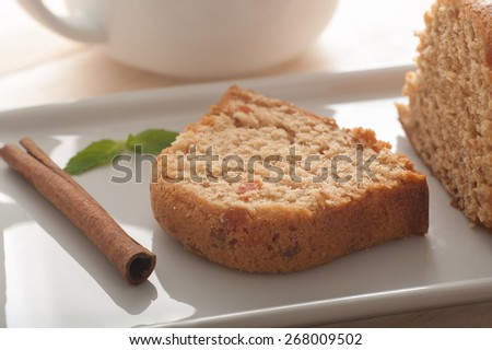 Close up of a delicious carrot cake with cinnamon and mint - stock photo