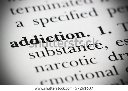 Close up of a dictionary word Addiction
