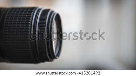 Close-up of a digital camera lens. Large copyspace. - stock photo