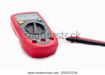 Close up of a digital multimeter with white background.